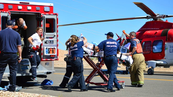 Life Flight and Mesquite Fire and Rescue crews take a burned victim to the helicopter after an the man man was injured in an explosion at Primex Wednesday, Sept. 24, 2014.