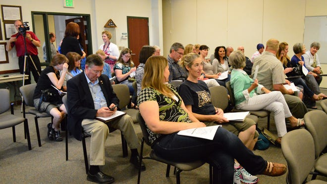 Washington County residents attend a meeting on the Science and Engineering Education Standards proposal at the Washington County School District offices. The proposal is in a comment period until July 9.