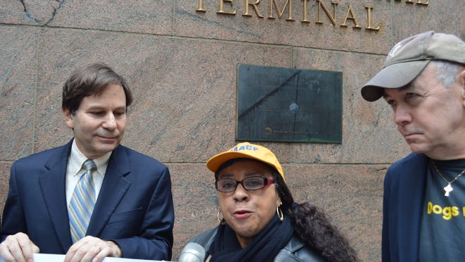 Lena Anderson, president of the NACCP White Plains-Greenburgh branch, was at Grand Central Terminal on Nov. 24 to call on Harrison and the MTA to include affordable housing in its project at the Harrison train station. She is flanked by Alexander Roberts, left, of Community Housing Innovations, and Dennis Hanratty, of Mount Vernon United Tenants.