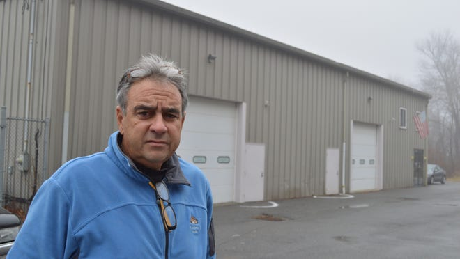 Steven Partenza, of Somers, stands by the building his company once owned in Kent, which Putnam County took for non-payment of taxes in 2011. He's fighting in state Supreme Court to get the building back.
