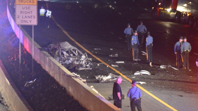State police on Wednesday identified the driver of this wrecked car, killed in this fiery wrong-way crash last week on I-95 near Newark, as a 30-year-old man from Bear.
