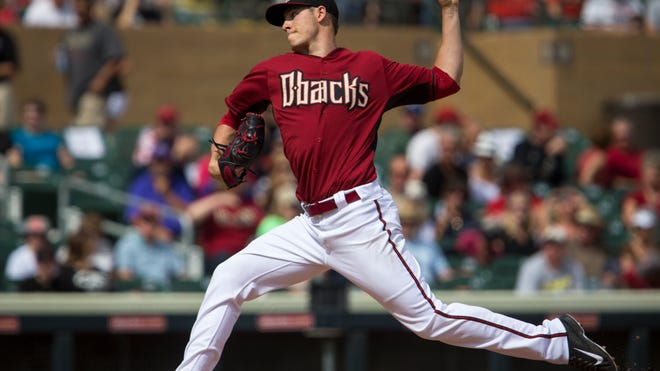 Feb. 27, 2014 - Pitcher Patrick Corbin throws in the first inning as the Diamondbacks play the Colorado Rockies at Salt River Fields.