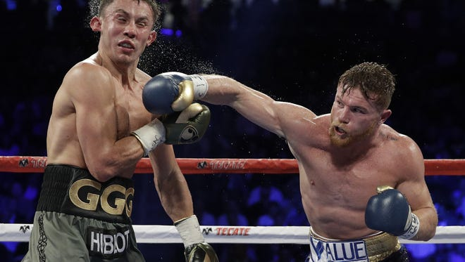 Canelo Alvarez, right, connects with a right to Gennady Golovkin during their first fight. Their second fight may be in jeopardy after Alvarez failed two drug tests.