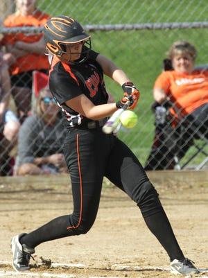 Lucas' Morgan Spitler hits the ball during a home game against Norwalk St. Paul on Thursday.