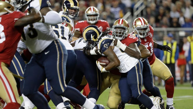 San Francisco 49ers defensive end Quinton Dial (92) tackles Los Angeles Rams running back Todd Gurley during the first half of an NFL football game in Santa Clara, Calif., Monday, Sept. 12, 2016. (AP Photo/Marcio Jose Sanchez) ORG XMIT: FXN