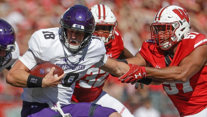 Wisconsin's Alec James sacks Northwestern's Clayton Thorson during the second half on Saturday.