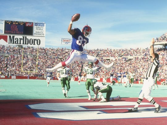Andre Reed scores a touchdown during a game against the Jets at Rich Stadium on Oct. 21, 1990.