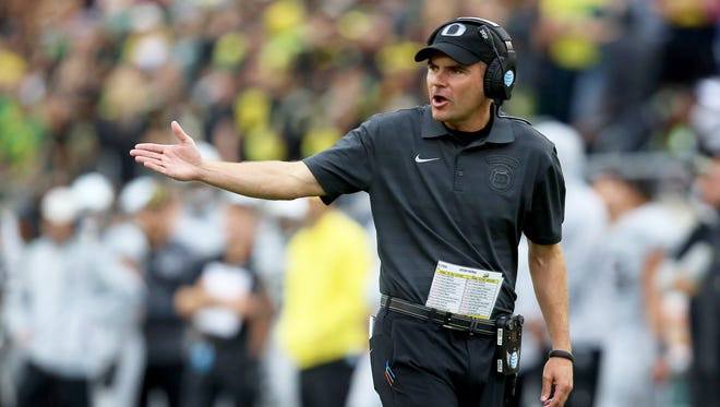 Oregon head coach Mark Helfrich talks to the referees during the first half of an NCAA college football game against Washington State Saturday, Oct. 10, 2015, in Eugene, Ore.