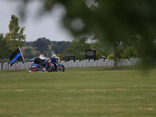 A member of the Patriot Guard rides in to the Iowa
