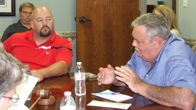 Dover Ward II Alderman Terry Odom, right, addresses the board about the bridge bid at the Sept. 14 meeting as fellow Ward II alderman, Robert Beecham, left.