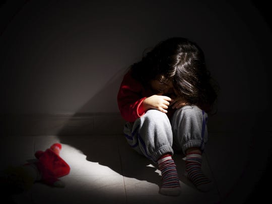 An illustration showing a child sitting in the dark. State officials say suicide rates among Nevada youths has spiked.
