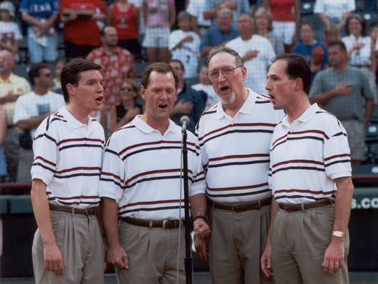 The Jubilee quartet singing the national anthem at a Texas Rangers Game. (L-R) Bother, Nathan Clark, David Goff, Dad, Bruce Clark, and Mark Clark.