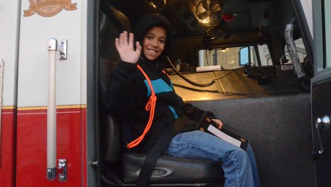 Tayshaun Twigg-Jackson prepares for his ride to school.