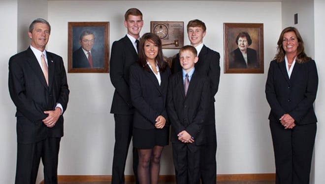 R. Scott Davis, left, his sons and niece, and his wife, Leichia Davis, own and operate the Roger W. Davis Funeral Home in West Portsmouth, Ohio. The funeral home handled the arrangements for the Rhoden family who were killed April 22, 2016.