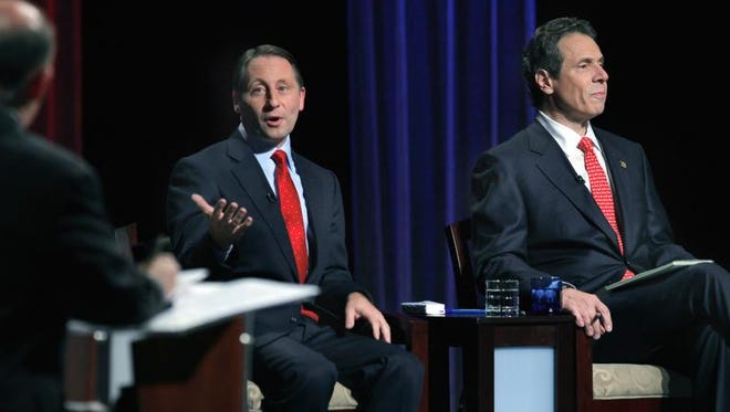 Rob Astorino, left, speaks as Gov. Andrew Cuomo waits his turn during Wednesday night's debate in Buffalo.