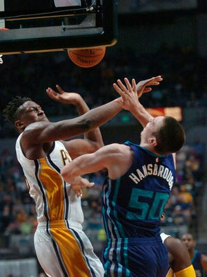 Indiana Pacers' Myles Turner, left, fouls Charlotte Hornets' Tyler Hansbrough (50) during the second half of an NBA preseason basketball game, Thursday, Oct. 22, 2015 in Fort Wayne, Ind.