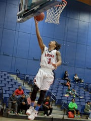 Lane College's Rodney Clarke goes up for a lay-up during