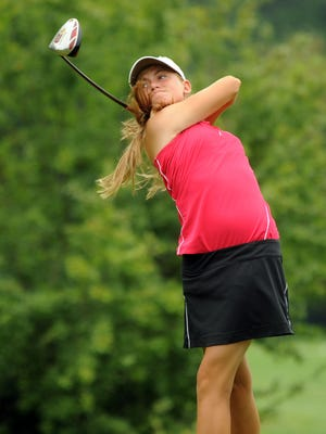 Jessica Porvasnik, 15, of Hinckley, tees off on the first hole during the final round of the Ohio Junior Girls Championship in 2010, which she won. She just finished her senior year as a member of the Ohio State women's golf team.