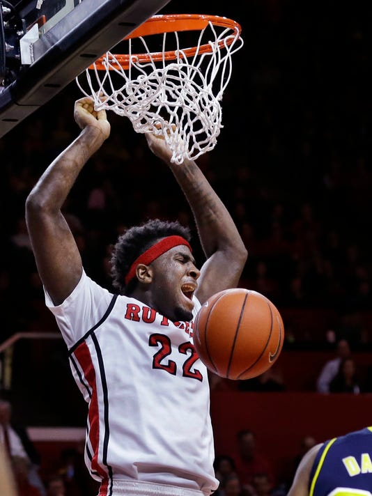 Rutgers D.J.Foreman (22) dunks a basket during the second half of an NCAA college basketball game against Michigan Tuesday, Jan. 20, 2015, in Piscataway, N.J. Michigan won 54-50. (AP Photo/Mel Evans)