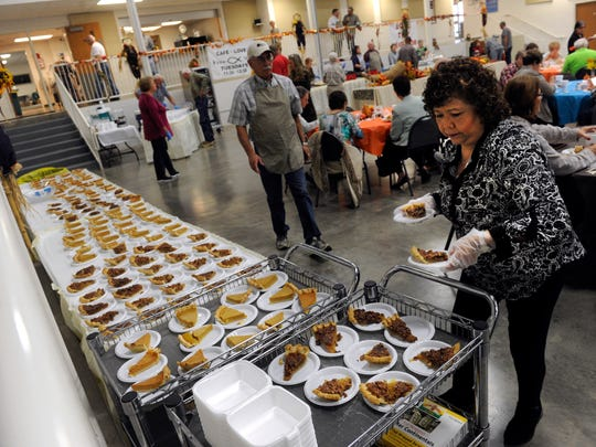Rosana Stirrup sets out slices of pumpkin pie and pecan pie during Thursday's Thanksgiving fundraiser at First United Methodist Church in Breckenridge.