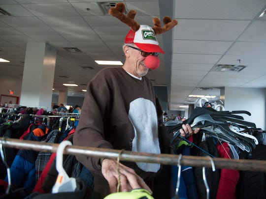 Volunteer Jim Mayhew of Oaklyn collects hangers during
