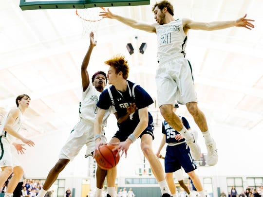 Grace Christian's Baylor Younker (44) is blocked by Webb's Gavin Norwood (1) and Myles Rasnick (21) during a game between Webb and grace Christian at Webb High School in Knoxville, Tennessee on Friday, January 19, 2018.