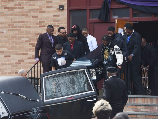 Caval Haylett Jr.'s casket is carried to the hearse