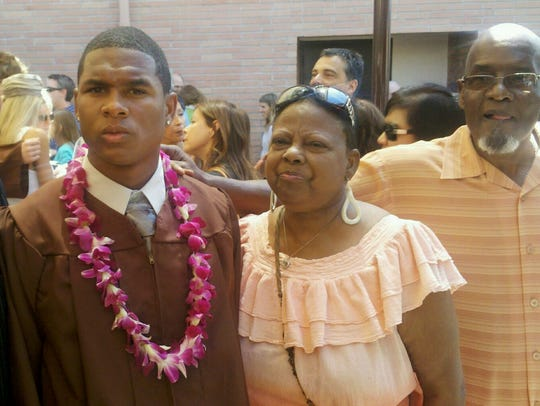 Detroit Lions defensive back Charles Washington IV, left, with his grandmother, Sue, and grandfather, Charles Washington Jr. at his high school graduation in 2011.