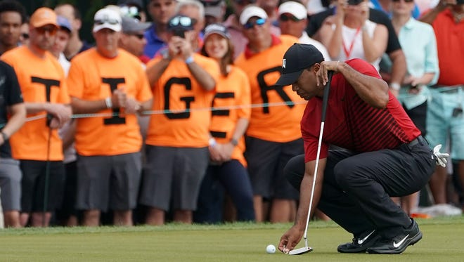 Tiger Woods lines up a during the final round of the Valspar Championship, where he finished tied for second place.