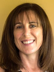 Maria Shuey,  Century 21 Krall Real Estate agent.