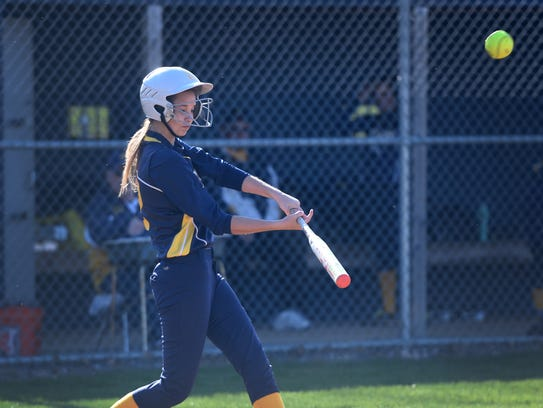 Elco's Courtney Henry connects for one of Elco's 12