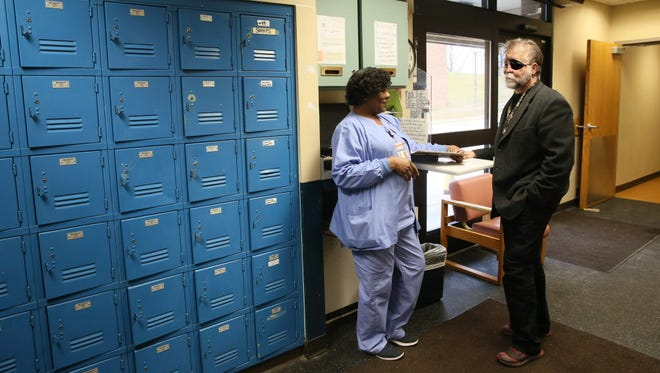 Floria Hill (left), a nurse at the Mental Health Complex in Wauwatosa, speaks with John Schneider, chief medical officer of the Behavioral Health Division, last month.