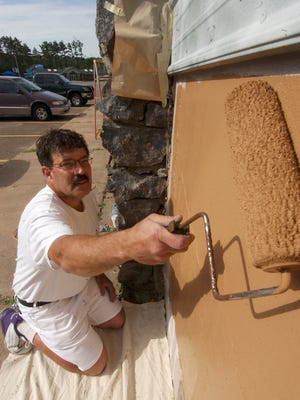 In this 2006 file photo, Jeff Campo paints the exterior of the Rothschild Pavilion. Campo's work on the Pavilion and other community projects allowed him to work with many young people who were on court-ordered community service.