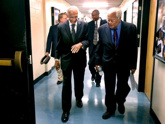 Civil rights leaders, theRev. C.T. Vivian, left, and theRev. James Lawson talk as they walk  to an MTSU voting-rights panel discussion Thursday, Sept. 17, 2015.