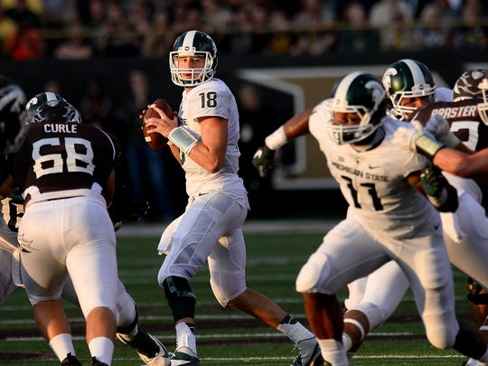 MSU quarterback Connor Cook looks downfield as he readies to pass in MSU's opener at Western Michigan. Cook is closing in on many of MSU's passing records.