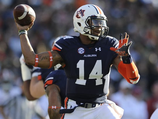 Auburn quarterback Nick Marshall throws a pass against Alabama in the Iron Bowl on Saturday, Nov. 30, 2013.