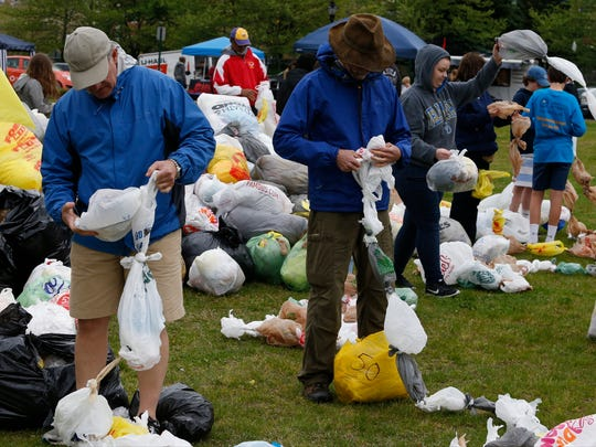 Volunteers tie thousands of plastic bags together in an attempt to set a world record for plastic bag ball at the Wilmington Riverfront on April 24. The General Assembly is considering charging for plastic bags at stores.