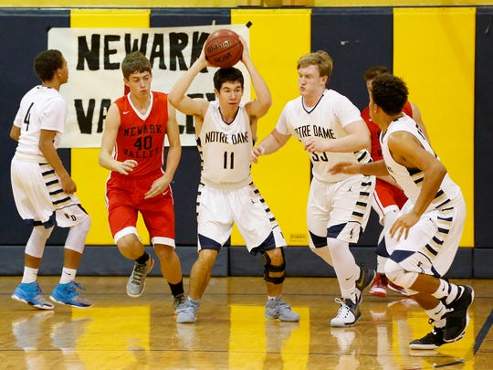 Notre Dame's Pat Brown looks for an opening after gaining control of the ball against Newark Valley earlier this season.