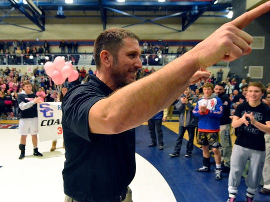 Spring Grove wrestling coach Tony Miller celebrates his 300th win with the Rockets after defeating Central York 47-13, Thursday, December 22, 2016.  John A. Pavoncello photo