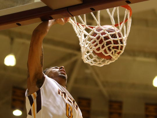 Midwestern State's Brandon Neel dunks in the game against