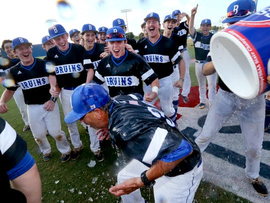 Brentwood baseball players dump water on coach Bill Moore's head after the win over Stewarts Creek during the Class AAA state championship game last year.