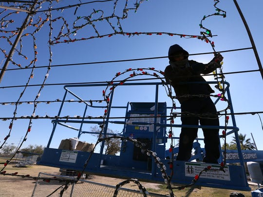 County employee Eddie Rodriguez replaces bulbs on one of more than 30 lighted displays placed throughout Ascarate Park on Friday in anticipation of Saturday's official lighting ceremony for the Lights on the Lake holiday celebration. The event starts at 5 p.m. with the lighting ceremony at 6:30 p.m., said Alexandra South, marketing specialist with El Paso County Parks and Special Events. Food trucks will be on hand. The lights will be on each night through Jan. 6.