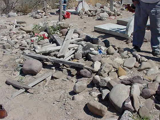 The grave containing the remains of 15 boys and men massacred in Porvenir, Texas, is at a cemetery across the border in Mexico. Family members took the remains there for burial.