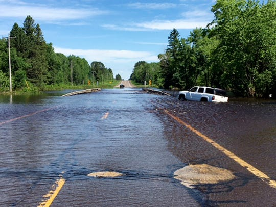 Flash flooding along Wisconsin Highway 35 over Black River in Pattison State Park in Douglas County in June 2018 made roads impassable.