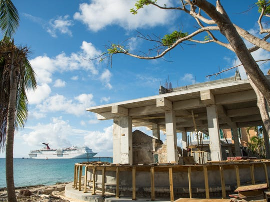 A 2,600-passenger Carnival cruise ship, housing hurricane relief workers in Frederiksted's port, is seen from grounds from The Fred, the town's newest hotel.