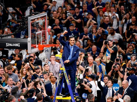 In this April 2, 2018, file photo, Villanova head coach Jay Wright reacts after cutting down the net after beating Michigan 79-62 in the championship game of the Final Four NCAA college basketball tournament, in San Antonio.