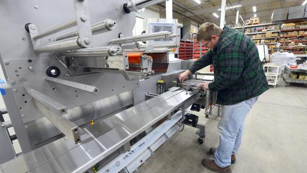 David Vlies, a metal fabricator at Campbell Wrapper in De Pere, works on a flow wrapper machine that will be delivered to Lakeshore Technical College on Tuesday.