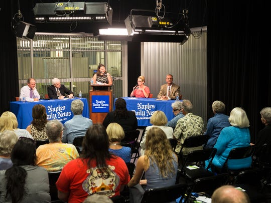 Rep. Tamara Paquette, second from right, answers a question next to her opponent Rep. Bill McDaniel during the Collier County Commission Forum for District 5 at the Naples Daily News studio on Thursday, Oct. 27, 2016.