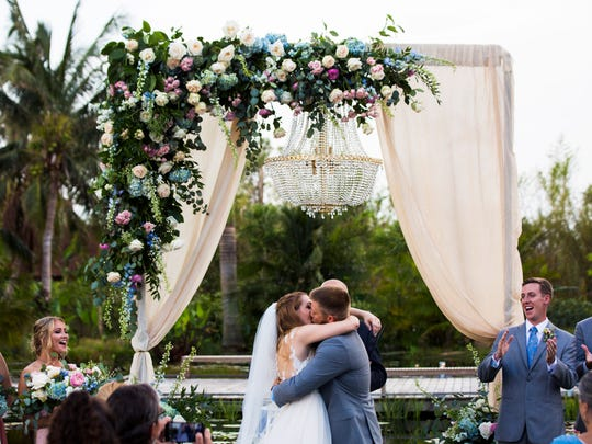 Chelsea Lange and Jacob Pytlik kiss for the first time as husband and wife during their wedding at the Naples Botanical Garden on Saturday, Sept. 30, 2017.