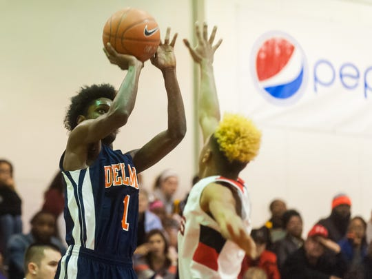 Delmar guard Larry Ennis (1) takes a shot against Laurel at Laurel High on Thursday night.